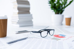 composition-with-eyeglasses-and-business-documents-592RUT9.jpg